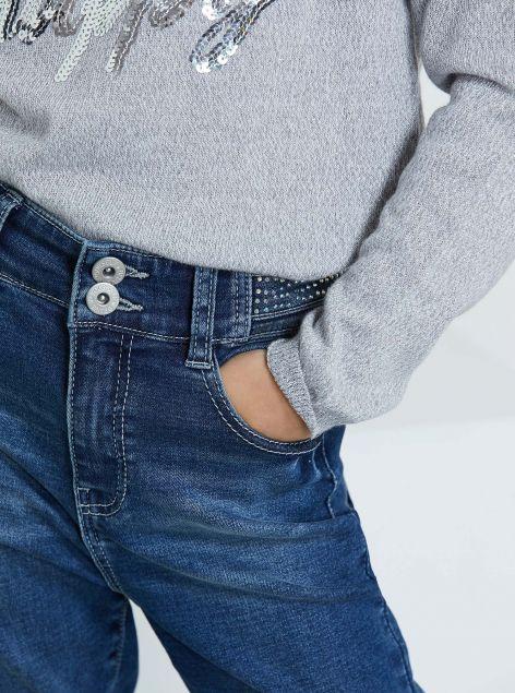 Jeans vita alta con applicazioni