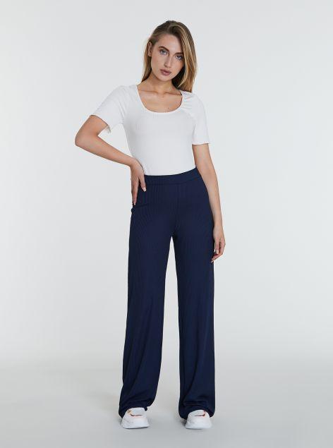 Pantaloni a zampa con costine
