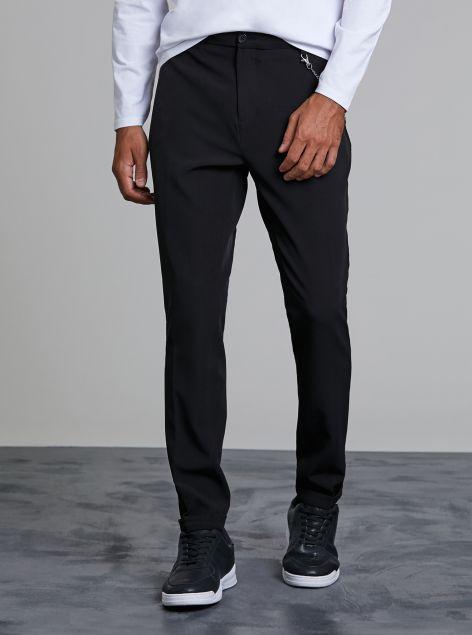 Pantalone chino con catena
