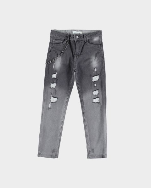 Jeans con strappi e catena
