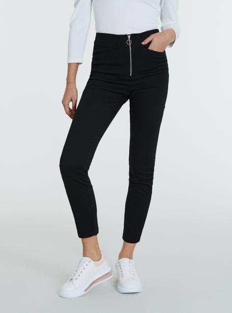 Pantaloni con zip centrale