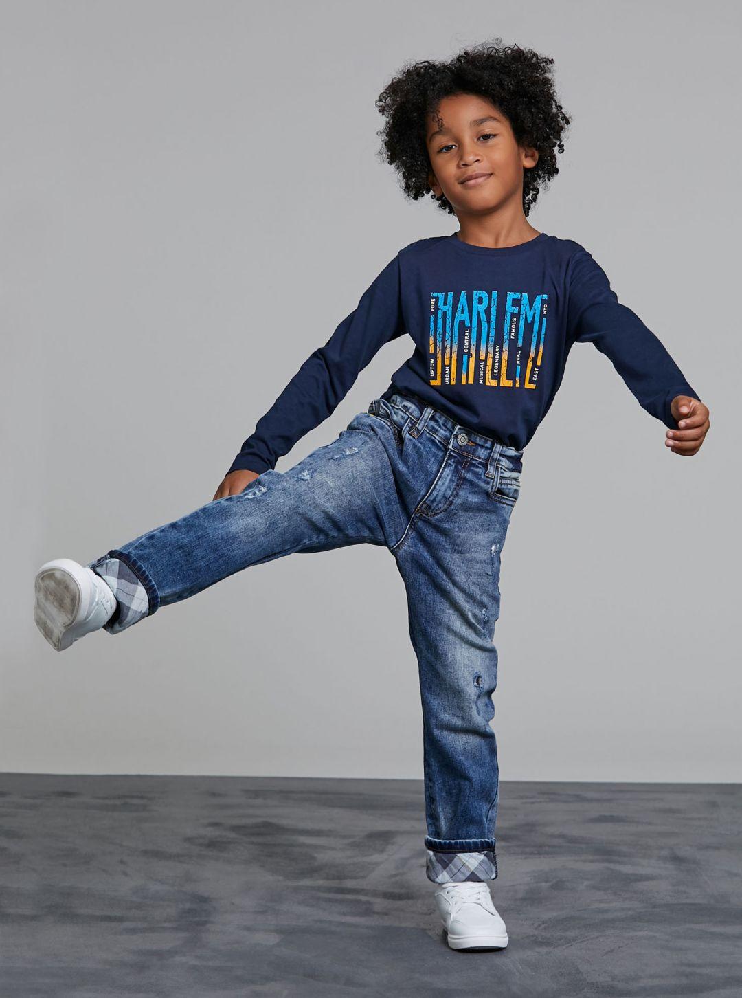 Jeans con risvolti scozzesi