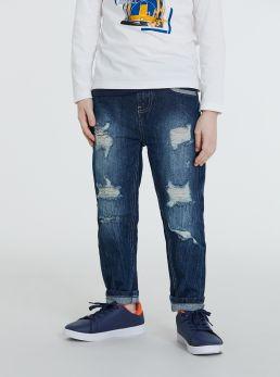 Jeans scuro con strappi ed applicazioni