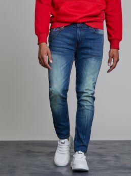 Jeans con catena applicata