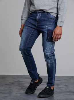 Jeans con toppe