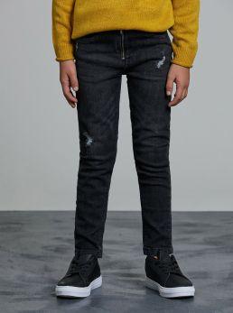 Jeans con microstrappi