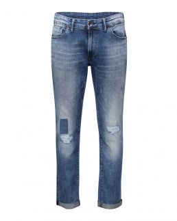 Jeans slim con applicazioni e strappi